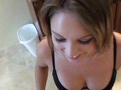 Girlfriend in a black lingerie set is happy to get on her knees and blow her man